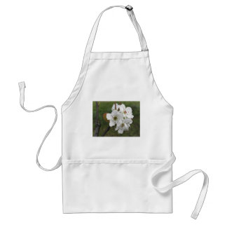 Blossoming pear tree against the green garden standard apron