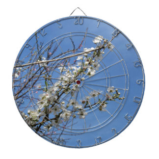 Blossoming plum against the sky . Tuscany, Italy Dartboard