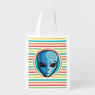 Blue Alien on Bright Rainbow Stripes