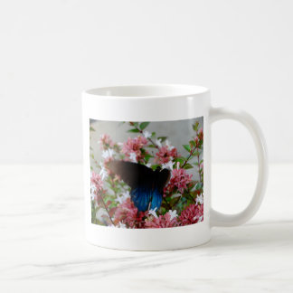 Blue and Black Butterfly on pink flowers Coffee Mug