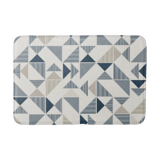 Blue and tan geometric triangles on bath mat
