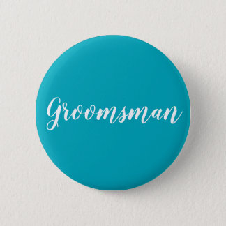 "Blue and white ""Groomsman"" button"
