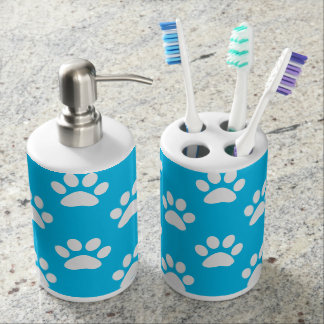 Blue and white paws pattern soap dispenser and toothbrush holder