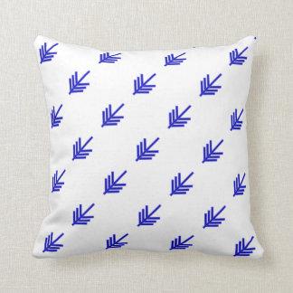 Blue arrow design on white cushion
