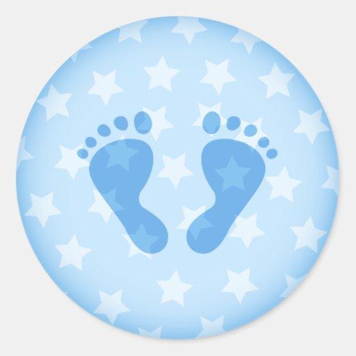 Blue baby footprints on a starry background round sticker