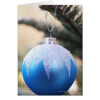 Blue bauble on Christmas tree, close up Card