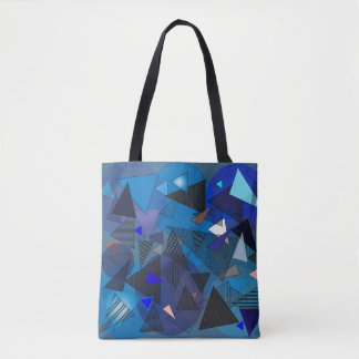 blue, black, and patterned triangles tote bag