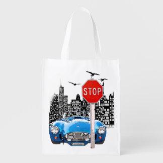 Blue car and cityscape reusable bag.