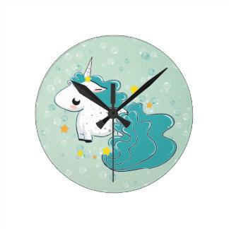 blue cartoon unicorn with stars clock