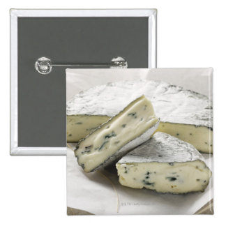 Blue cheese with pieces cut on paper 15 cm square badge
