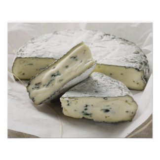 Blue cheese with pieces cut on paper poster