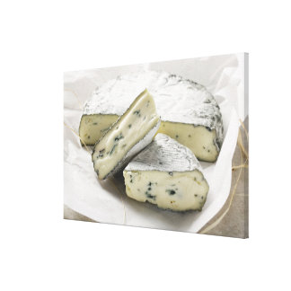 Blue cheese with pieces cut on paper stretched canvas print