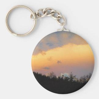Blue clouds in a lavender sky key chain