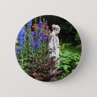Blue delphinium flower garden and statue 6 cm round badge