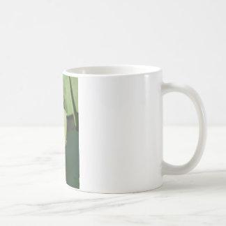 Blue Dragonfly on a green leaf. Coffee Mug