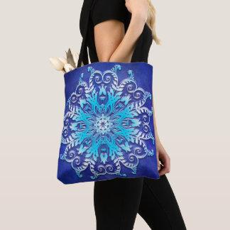Blue floral mandala on grunge background. tote bag