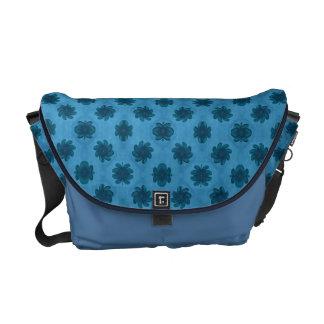blue floral pattern courier bag