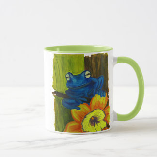 Blue frog relaxing on flower and tree branch mug