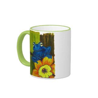 Blue frog relaxing on flower and tree branch ringer mug
