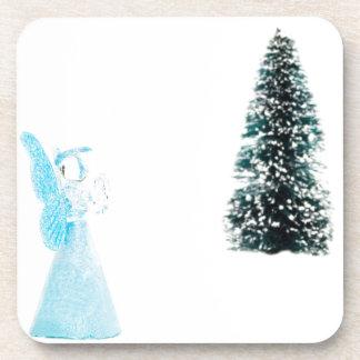 Blue glass angel praying near christmas tree coaster