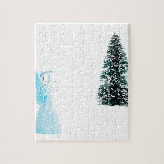 Blue glass angel praying near christmas tree puzzle