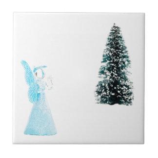 Blue glass angel praying near christmas tree small square tile