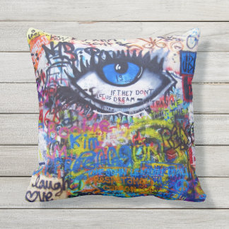 Blue graffiti evil eye cushion