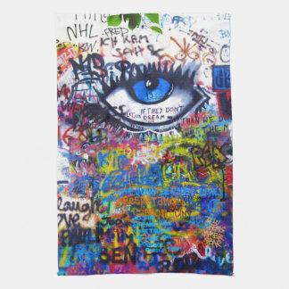 Blue graffiti evil eye tea towel