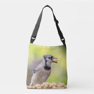 Blue jay with a peanut crossbody bag