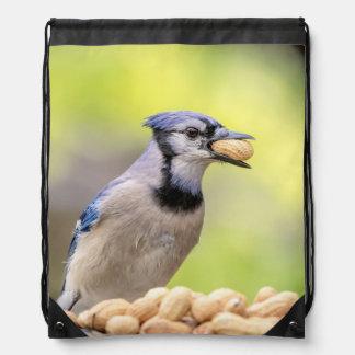Blue jay with a peanut drawstring bag