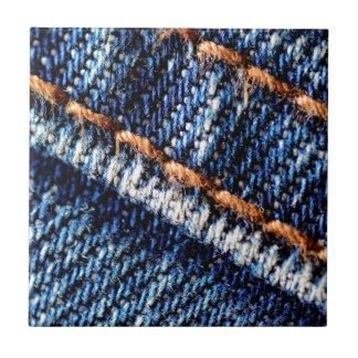 Blue jeans closeup texture. small square tile