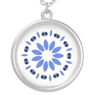 Blue leaf design on white pendants