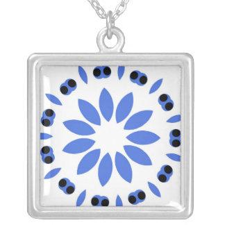 Blue leaf design on white square pendant necklace
