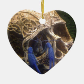 Blue lobster crayfish hanging out in a skull eye ceramic ornament
