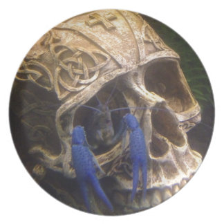 Blue lobster crayfish hanging out in a skull eye plate