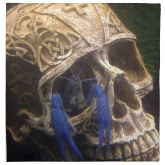 Blue lobster crayfish hanging out in a skull eye printed napkin