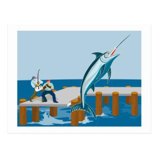 Blue marlin jumping with fisherman postcard