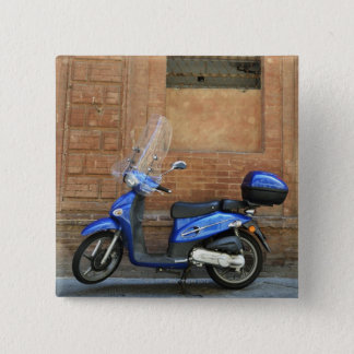 Blue motor scooter by red wall, Siena, Italy 15 Cm Square Badge