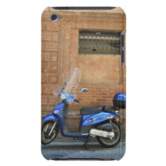 Blue motor scooter by red wall, Siena, Italy iPod Touch Covers