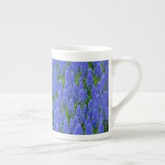 Blue muscari flowers tea cup