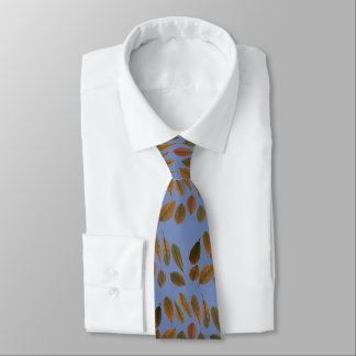 Blue necktie with brown dry leaves of autumn