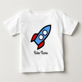 Blue rocket flying. baby T-Shirt