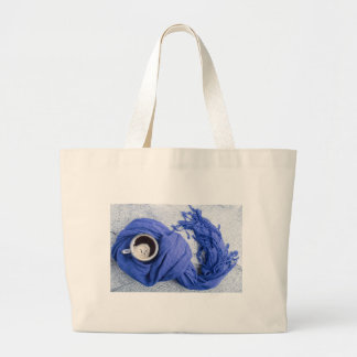 Blue scarf tied around the mug with hot coffee large tote bag