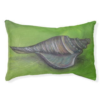 blue seashell on green dog bed