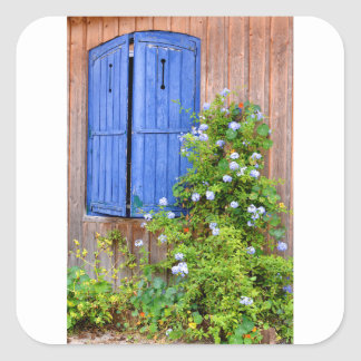 Blue shutters and flowers square sticker