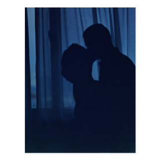 Blue silhouette couple kissing analogue film photo postcard