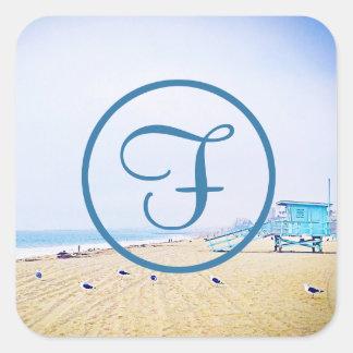 Blue sky and sandy beach photo custom monogram square sticker