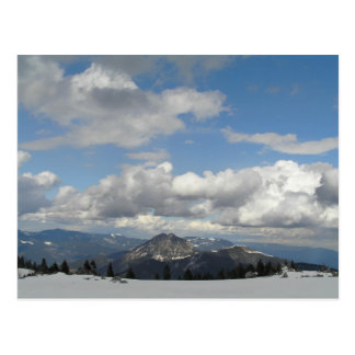 Blue sky behind clouds postcard