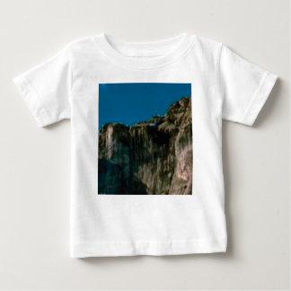 blue sky rock cliffs baby T-Shirt