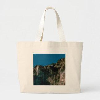 blue sky rock cliffs large tote bag